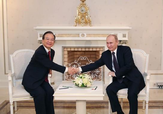 温家宝会见俄罗斯总统普京